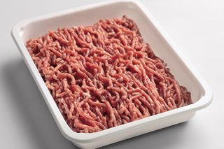 Minced meat portion deposited in polystyrene tray