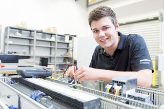 Electronics technician for industrial engineering