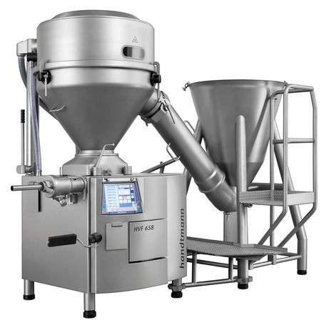 Inline grinding system integrated into high vacuum filler