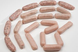 Fresh sausages in strings