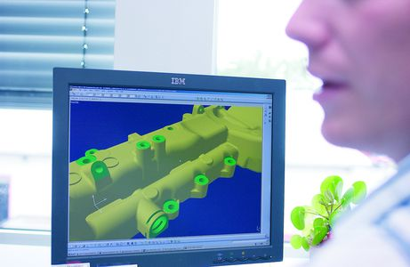 Employee using CAD for product development